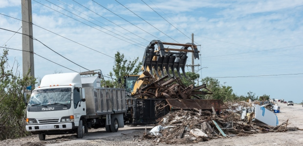 This Nov. 27, 2017, photo from Ramrod Key, Fla., shows contractors using heavy equipment and trucks to haul debris from a highway after Hurricane Irma. (Howard Greenblatt/FEMA photo)